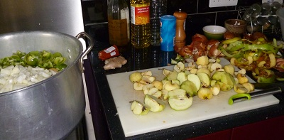 The tomatoes and onions are in the pan, now the apples, this year half from my trees, sharp and half from my inlaws trees, sweet, 1.3 kg down to just over a kilo peeled and cored, you could of course leave the peel on.